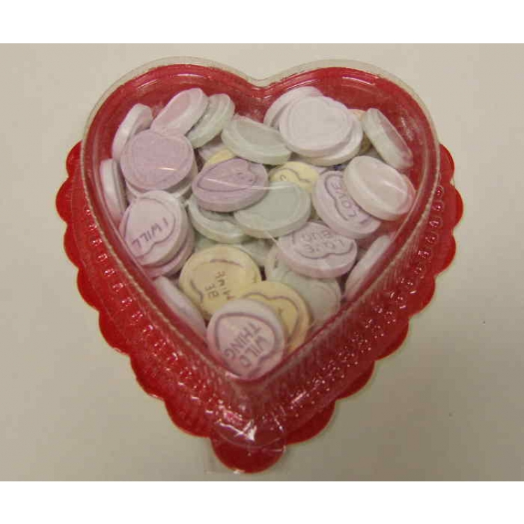 Lovehearts in a heart shaped container