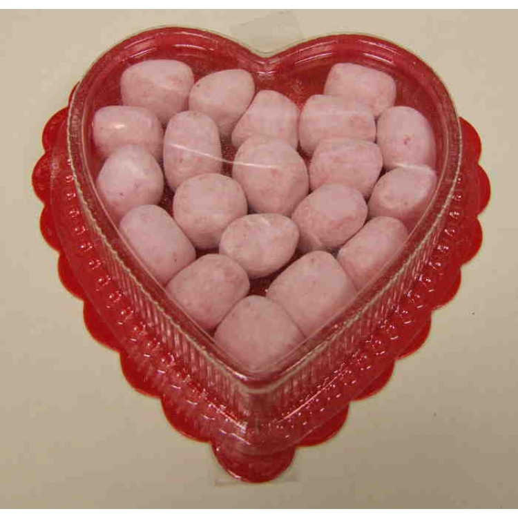 Strawberry bon bons in a heart shaped container
