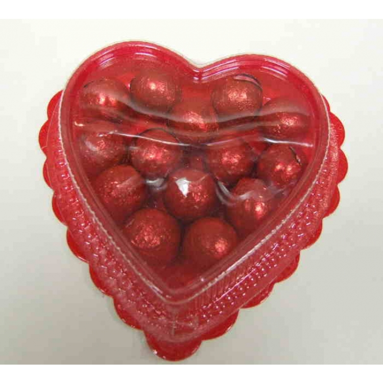 red foil-wrapped milk chocolate balls in a heart shaped container